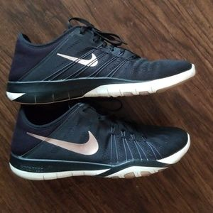 Nike black and rose gold training shoes